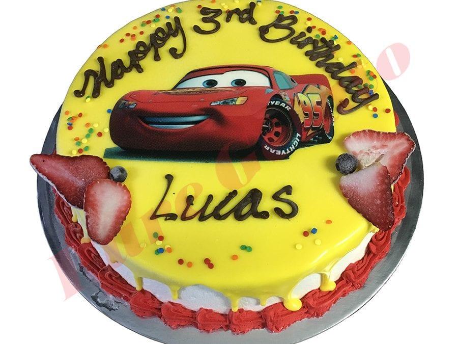 cars cake yellow choc drip red piping image