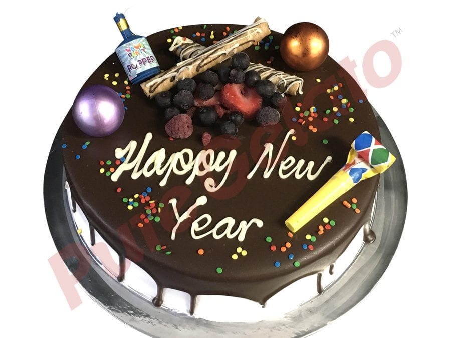 New Years Cake Chocolate Drip With Party Decorations