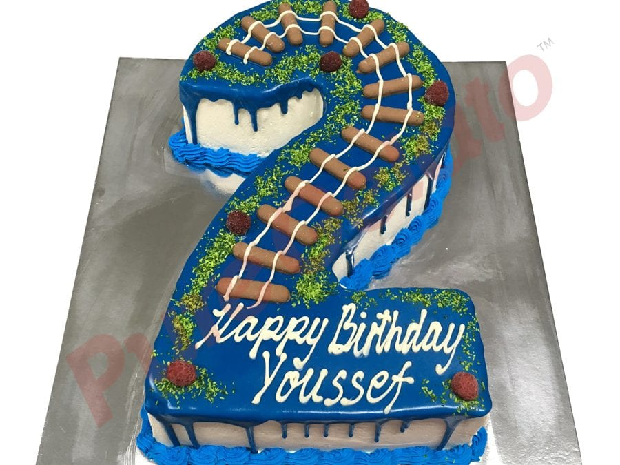 Numeral Cake 2 Blue Choc drip blue piping+train track