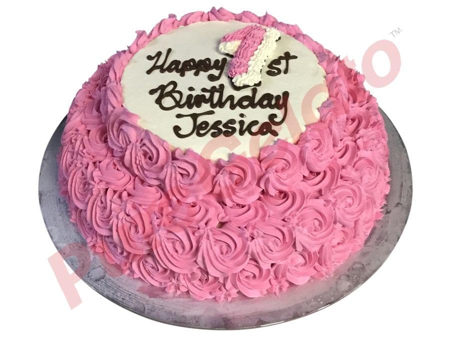 2 tier pink Cream decorated rosettes